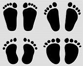 foto of wet feet  - Black prints of baby feet - JPG