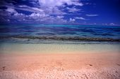 stock photo of french polynesia  - Sandy beach and crystal clear lagoon on the island of Moorea French Polynesia. ** Note: Soft Focus at 100%, best at smaller sizes - JPG