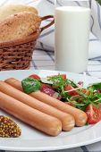 stock photo of wieners  - Wiener sausage with ketchup, mustard and salad.