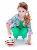 stock photo of dreidel  - Little girl spinning dreidel - JPG