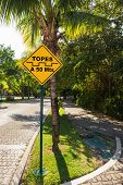 picture of playa del carmen  - Topes speed bump sign at caribbean street Playa del Carmen Mexico - JPG
