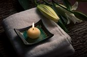 stock photo of top-less  - Aromatic candle and flowers  - JPG