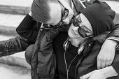 picture of cuddle  - Couple with style cuddling and kissing in park - JPG