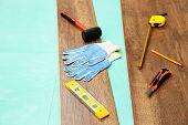 picture of laminate  - Carpenter tools on new laminate floor - JPG