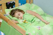 image of 6 year old  - six year old girl Europeans sleeping in her bed - JPG