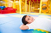 stock photo of playground  - Happy kid playing in playground - JPG