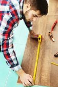 foto of laminate  - Carpenter worker installing laminate flooring in the room - JPG