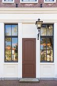 pic of windows doors  - Vintage door and window in front of the house with classic lamp beside - JPG