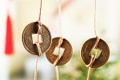 picture of copper coins  - Feng shui coins on light background - JPG