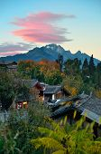 image of jade  - Lijiang Old Town with local historical architectures and Jade Dragon Snow Mountain - JPG