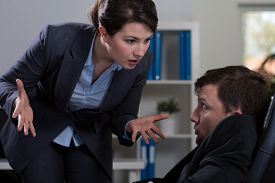 image of deprivation  - Horizontal view of victim of workplace bullying - JPG