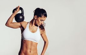 picture of sportswear  - Attractive young athlete with muscular body exercising  - JPG