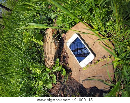 Smartphone On A Rock In A Meadow