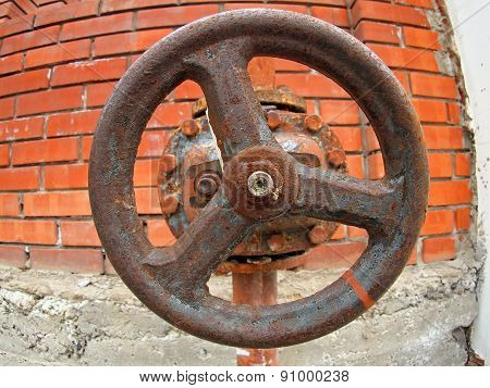 Large And Rusty Valve On The Water Pipe