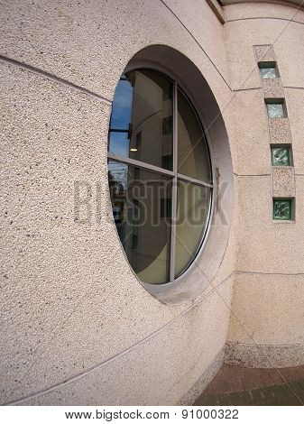 Detail Of A Wall Of An Office Building With A Round Window