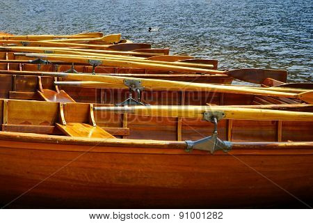 View Of Rowboats On A Lake