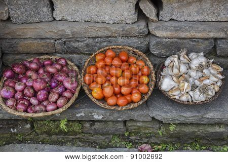 Closed Up The Basket Of Shallot, Garlic And Tomato