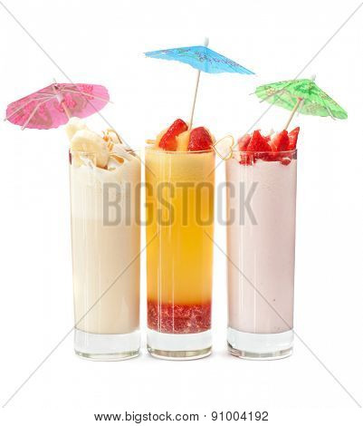 Set of three healthy nonalcoholic cocktails from berries banana and ice cream
