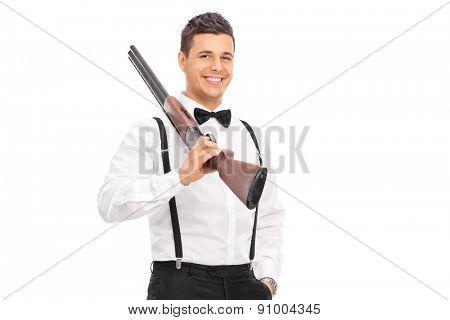 Elegant guy holding a shotgun over his shoulder isolated on white background