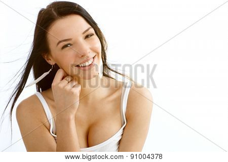 Portrait of beautiful young smiling woman.