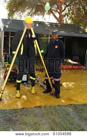 Black African Fireman Displaying Protective Clothing