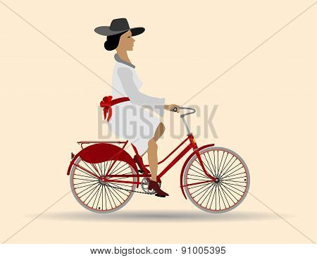 Beautiful lady on a red bike