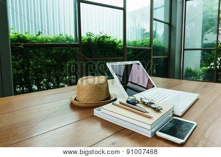 Laptop And Work Accessory On Wood Table