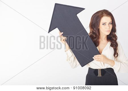 businesswoman with a black arrow pointing up