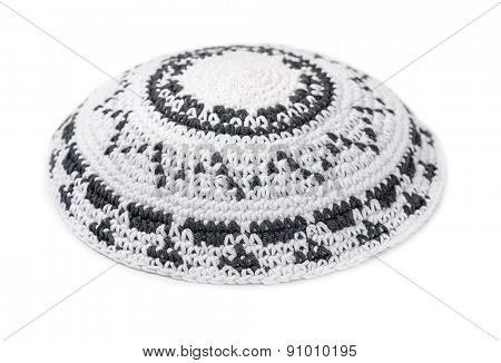White knitted jewish yarmulke isolated on white
