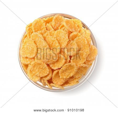 Top view of corn flakes in glass bowl isolated on white