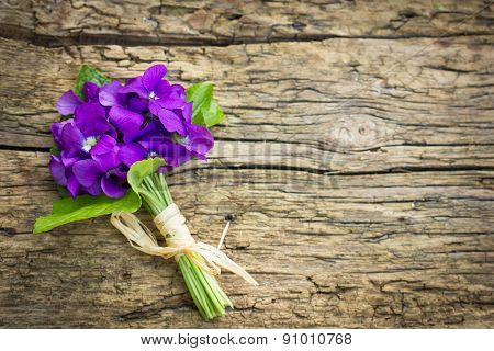 Beautiful bouquet of violets on the table