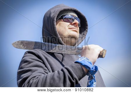 Man with machete on shoulder