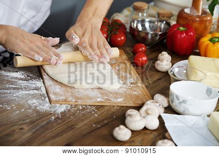 Cook prepare pizza dough