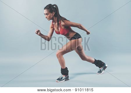 Sportive athlete woman sprinter waiting for the start running position fitness, sport, training and