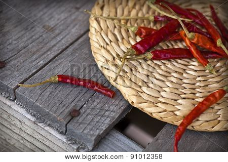 Red hot chili peppers on an old wooden table