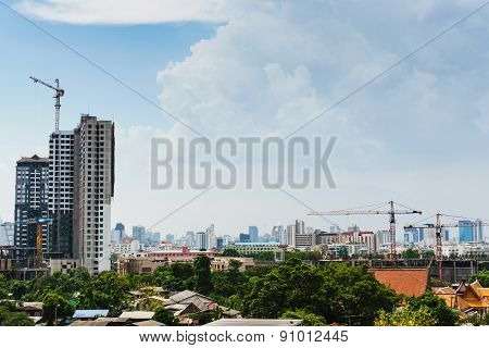 Cityscape With Tower Crane And Buildings Under Construction