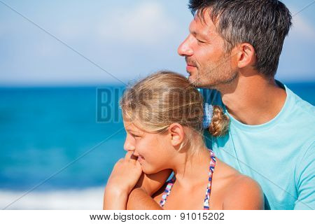 Father and his daughter at beach
