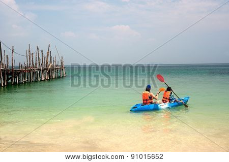 Tourist Paddle Canoe In Happiness.