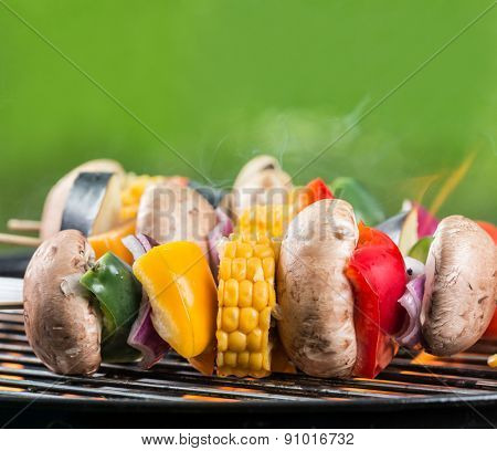 Delicious vegetable skewer on grill