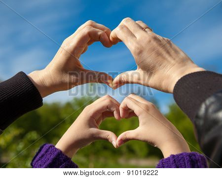 Girl And Her Mother Show Sign Of Heart With Their Hands
