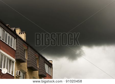 Dark Storm Cloud Over The Roof Of The House