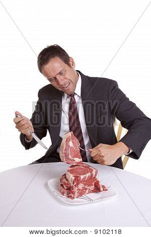 Man And Raw Steaks
