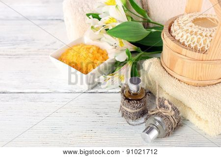 Spa still life with flower on wooden table, closeup