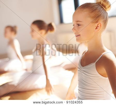 Pretty Little Blond Ballerina Smiling In Class