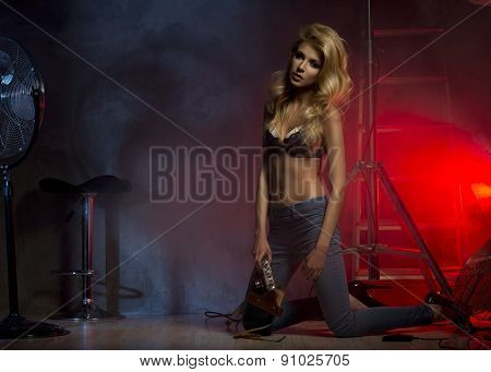 Sexy Blonde Woman With Photo Light Flash