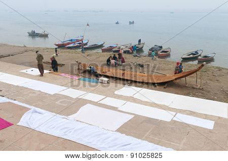 Indian People Make Boat On Ghat Near Sacred River Ganges In Varanasi