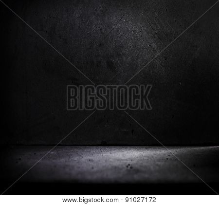 Dark stone or concrete room with slight incoming light.