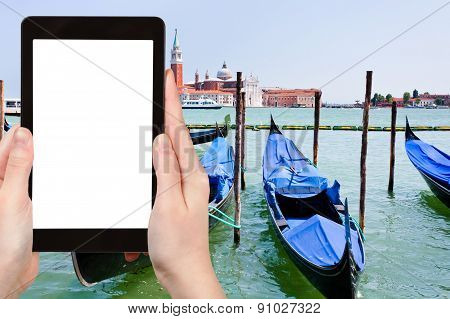Tourist Photographs Gondolas On San Marco Canal
