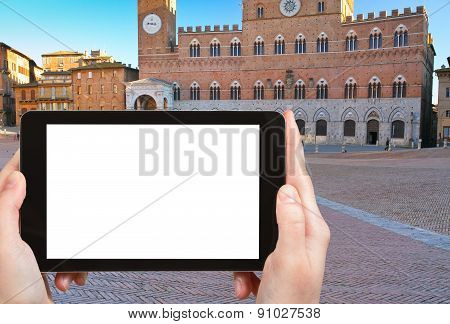 Tourist Photographs Piazza Del Campo In Siena, Italy