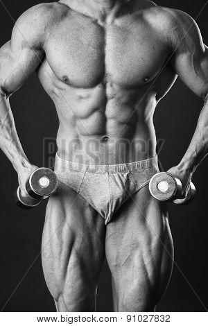 Man makes exercises dumbbells. Sport, power, dumbbells, tension, exercise.
